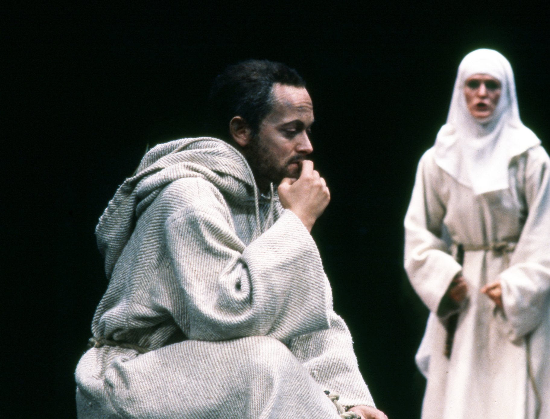 A nun and man in white robes.
