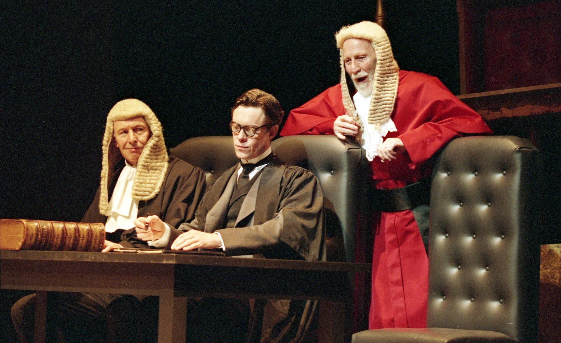 Two justices in wigs and a man in scholarly robes.