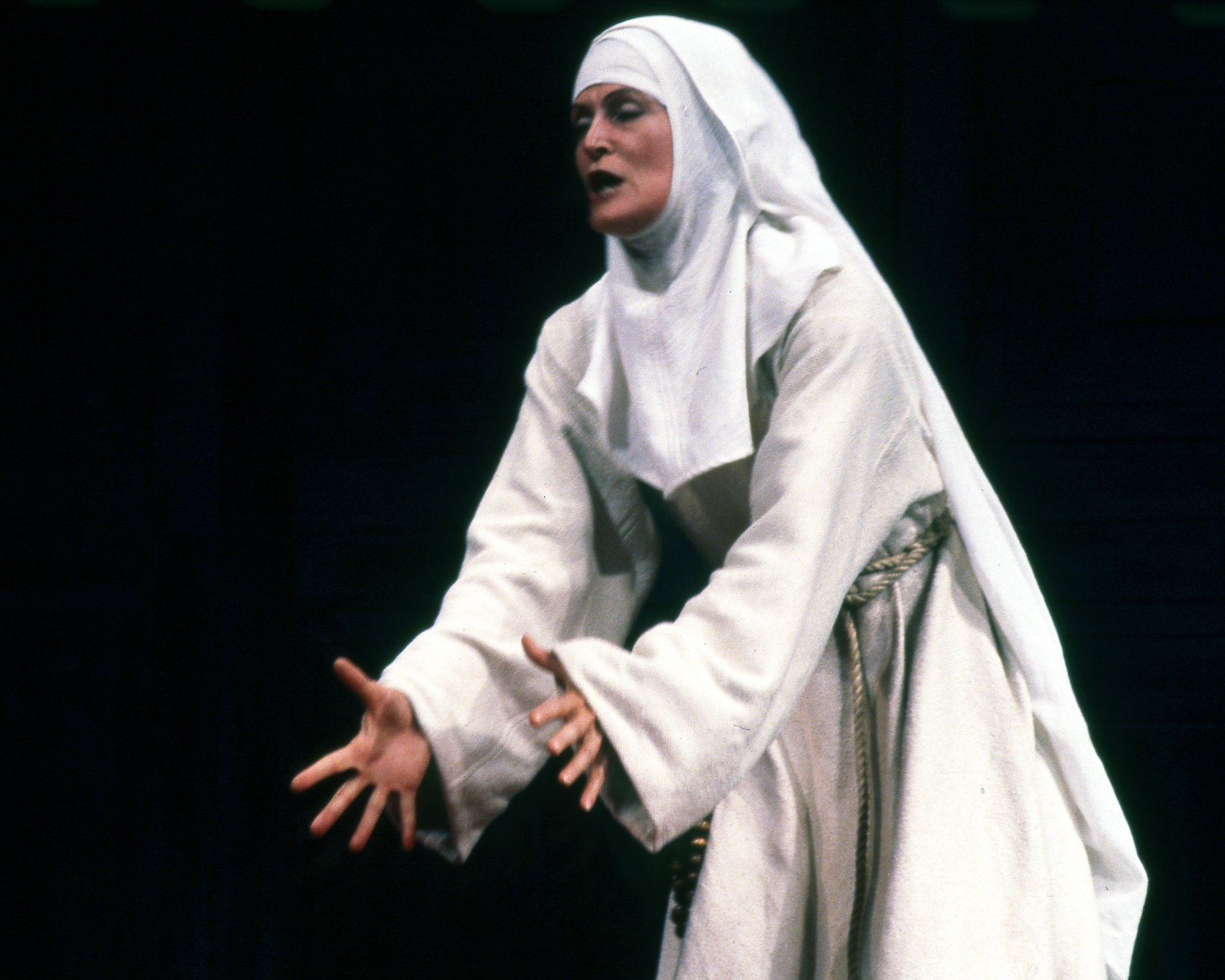 A nun dressed all in white.