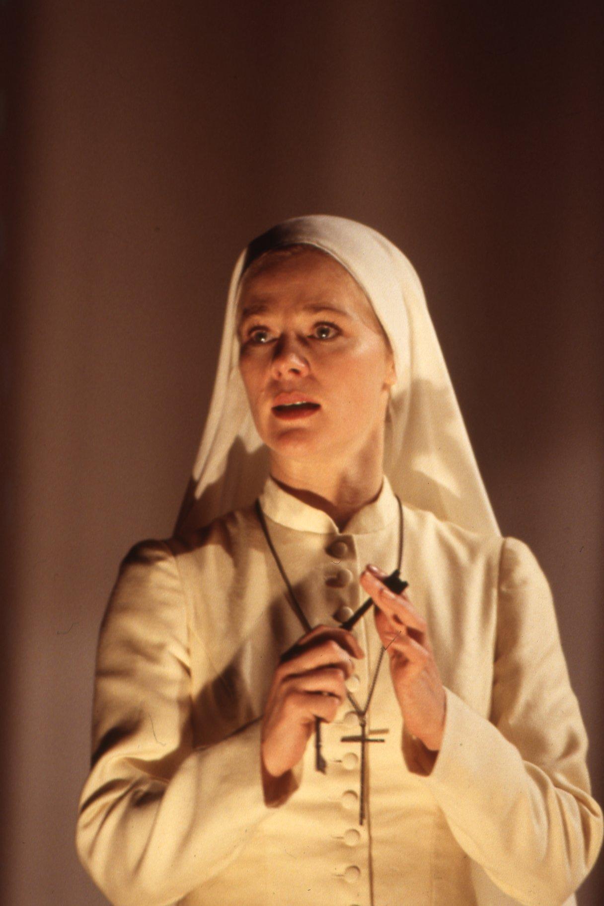 A nun in all white.