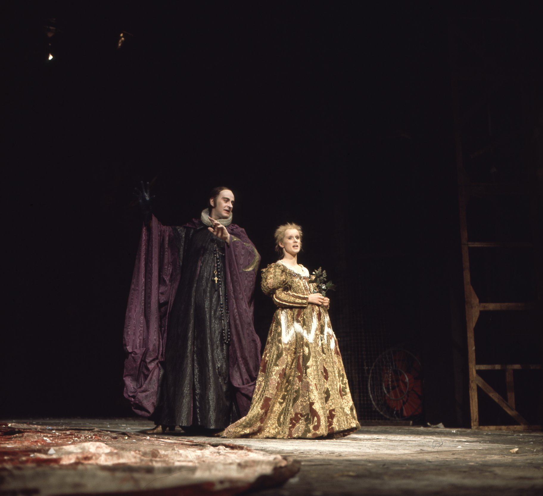 A man and woman in elaborate robes and dress.