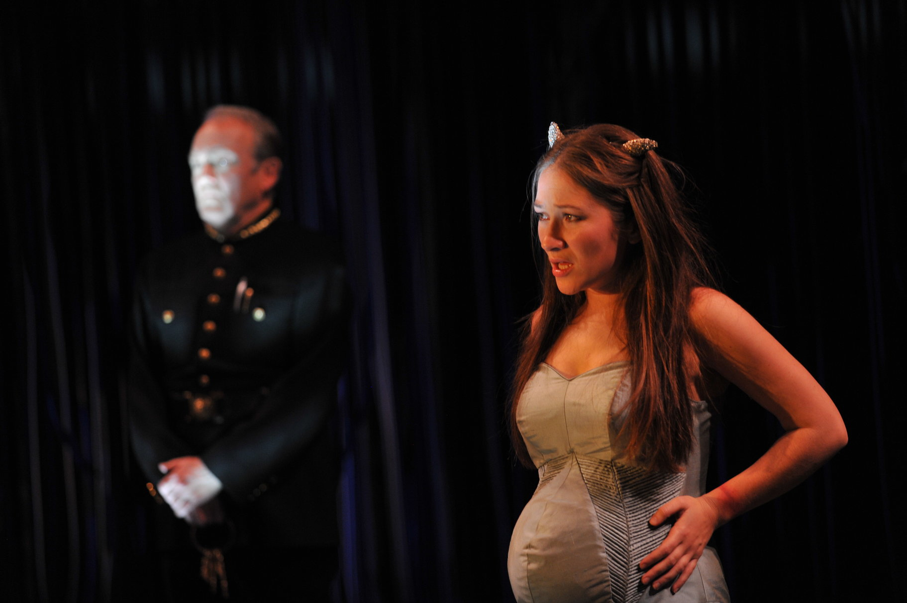 A heavily pregnant woman in a tight dress.