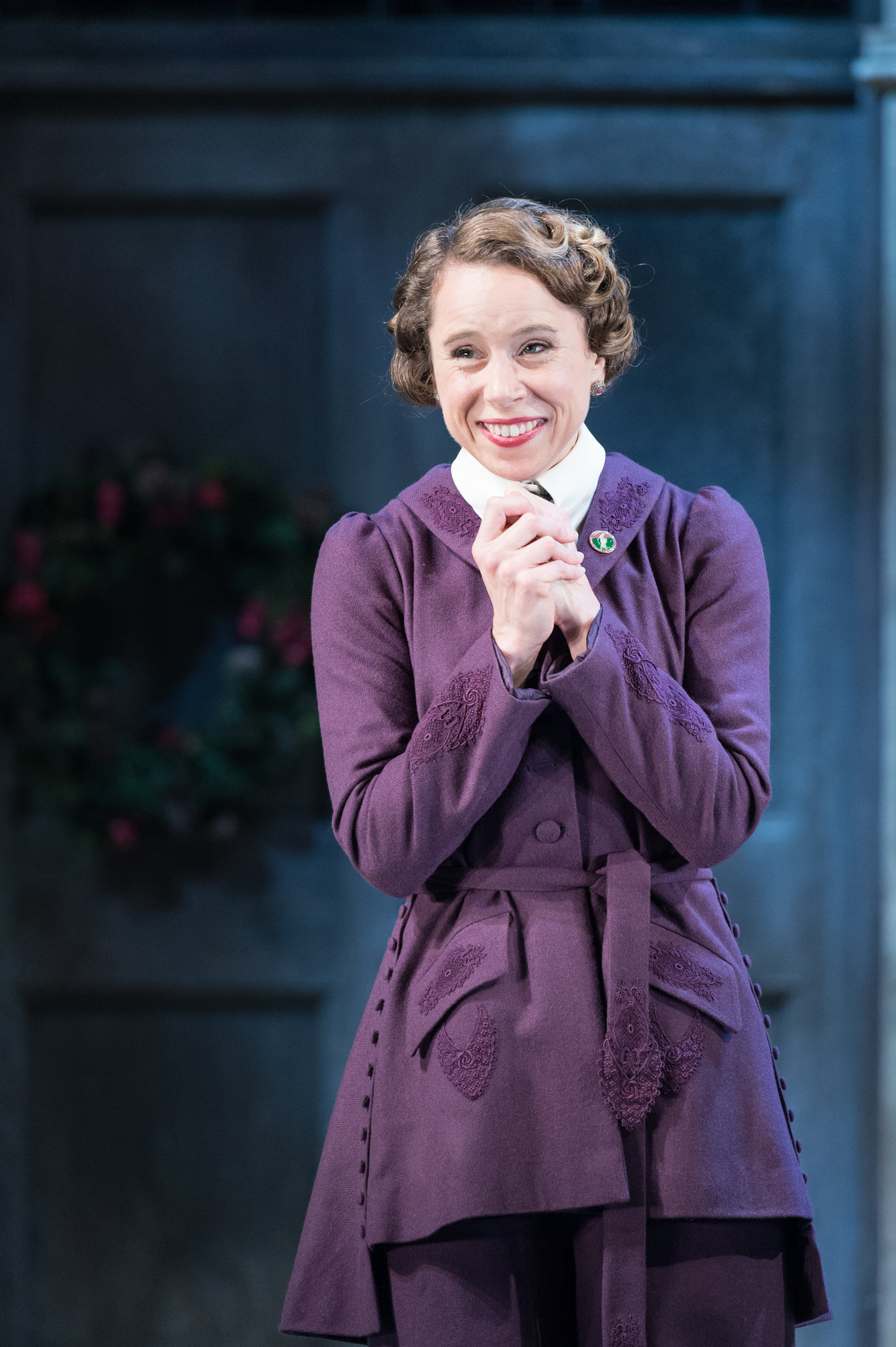 Michelle Terry as Beatrice in a purple suit.