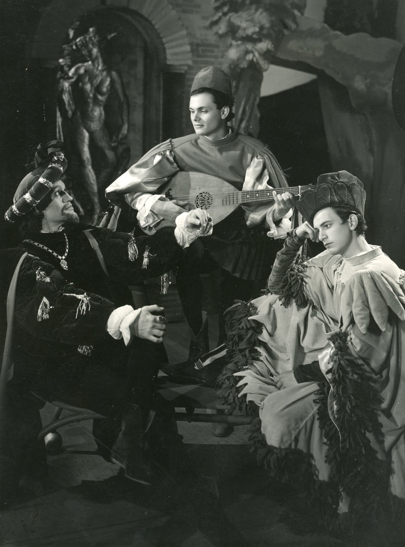 Don Pedro (Harry Andrews), Balthazar, (Paul Hansard) and Claudio (Philip Guard).