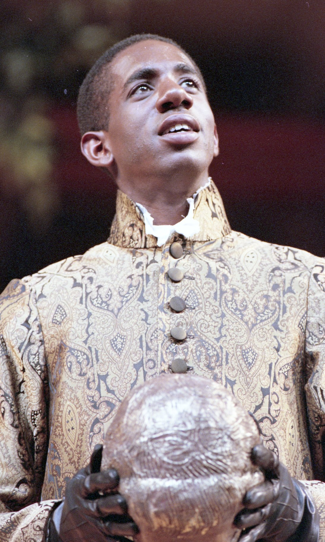 Rhashan Stone as Claudio at the masked ball.