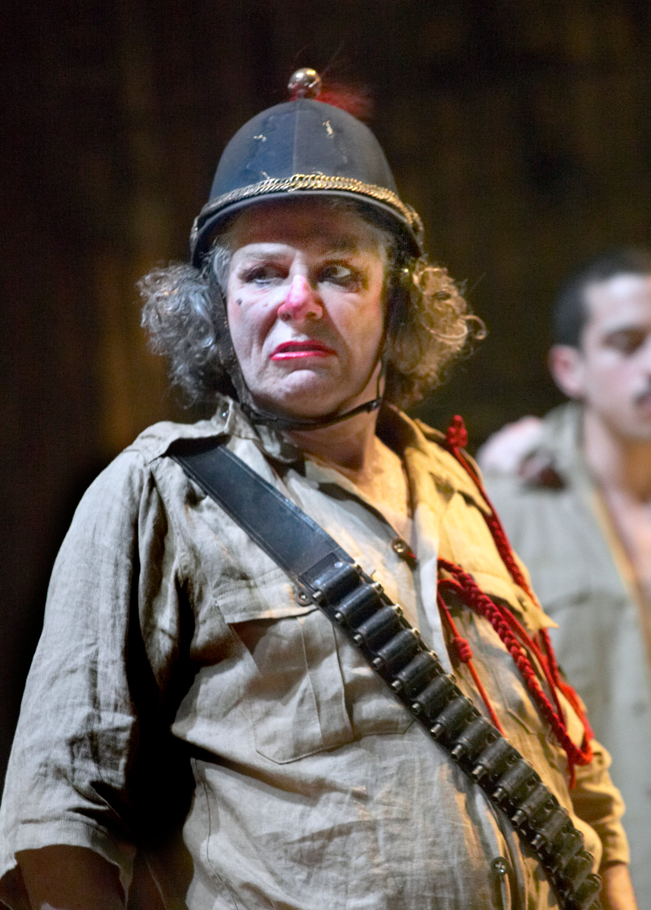 Bette Bourne as Dogberry in faded clown makeup.
