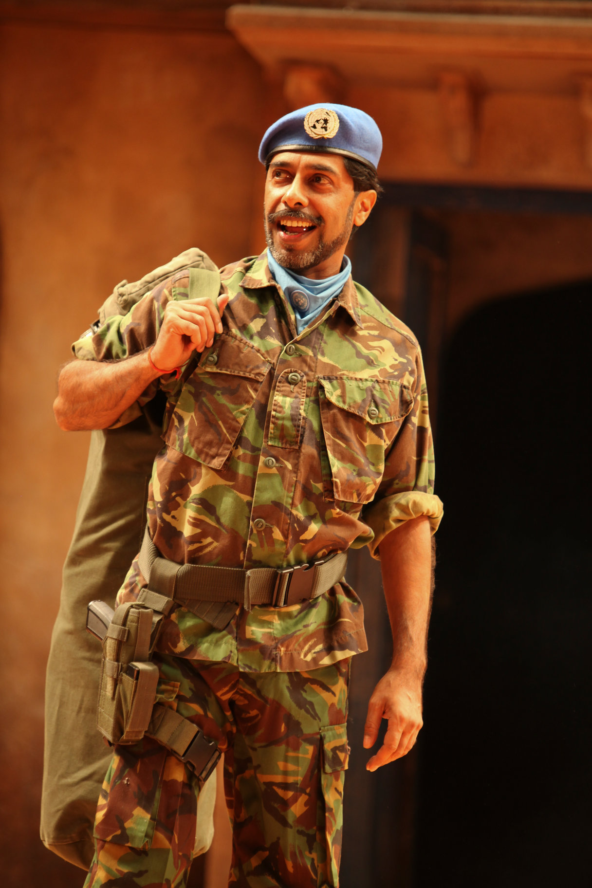 Shiv Grewal as Don Pedro in army fatigues.