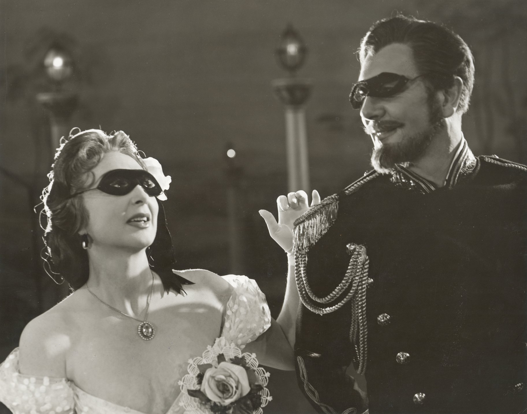 Benedick and Beatrice in their black masks.