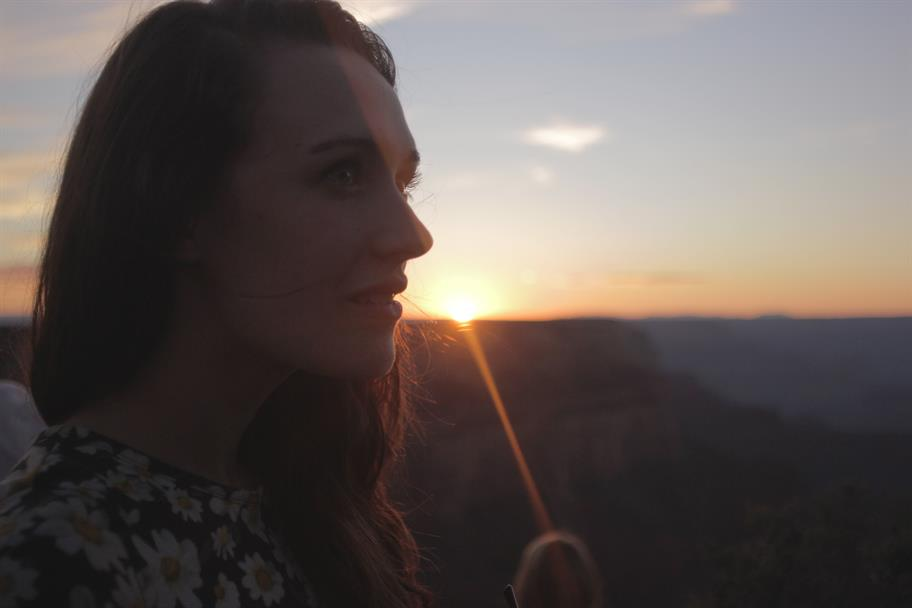 A woman silhouetted against a sunset