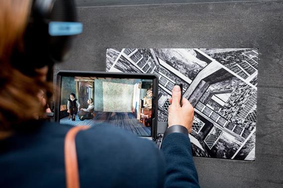 A tablet reveals a digital image