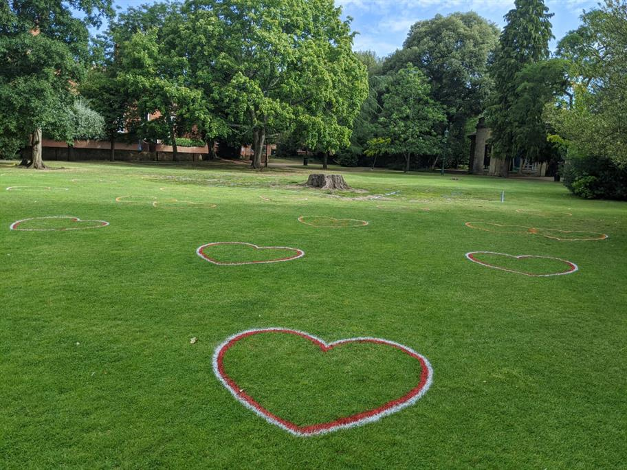 Heart-shaped boxes painted onto the Dell garden grass.