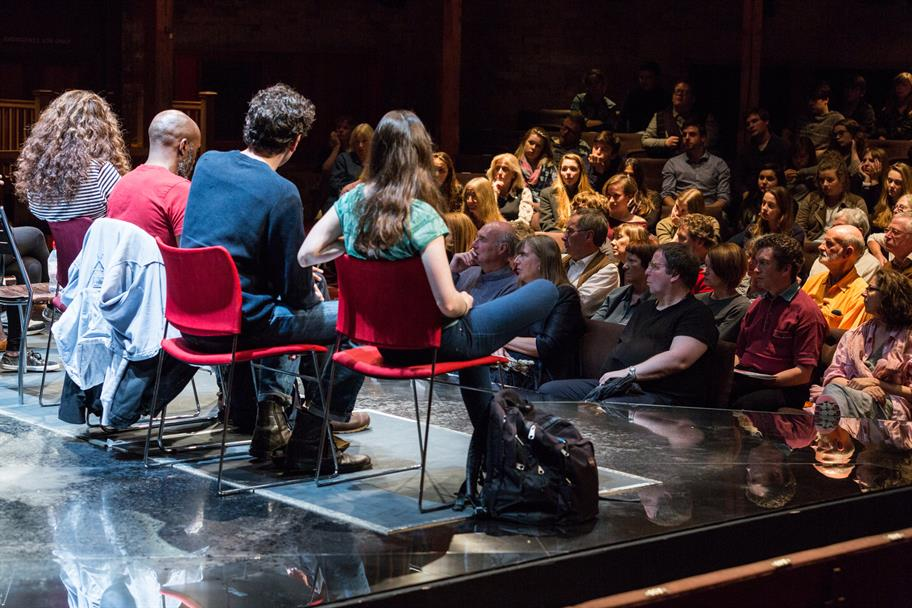 A panel discussion on stage in the Swan Theatre