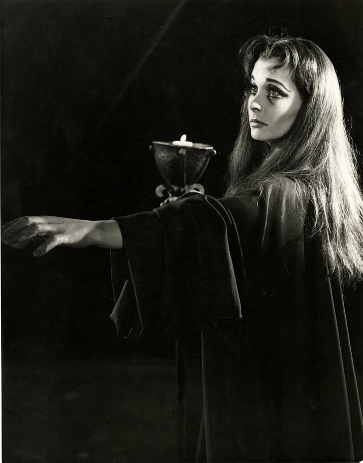 A black and white image of Lady Macbeth sleepwalking in the 1955 production of Macbeth.