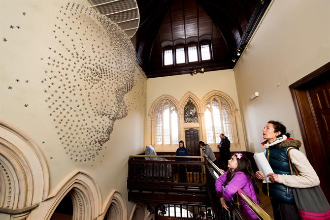 In the new Swan Wing, visitors are looking at the artwork For all time, a human face constructed by 2,000 suspended steel stars