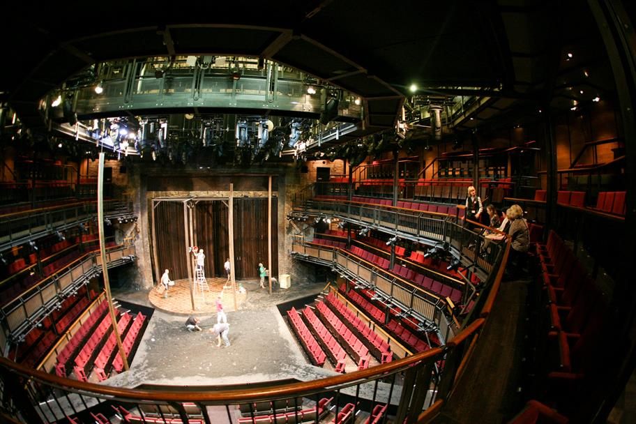 A member of RSC staff describes the process of changing one set to another on-stage.