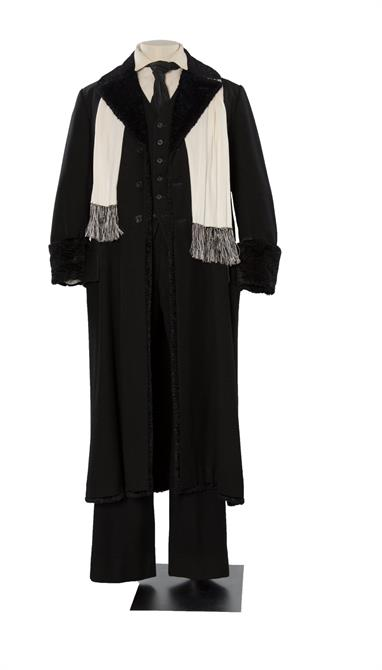 Black coat, trousers, waistcoat and white shirt and scarf worn by David Suchet as Shylock in 1981.
