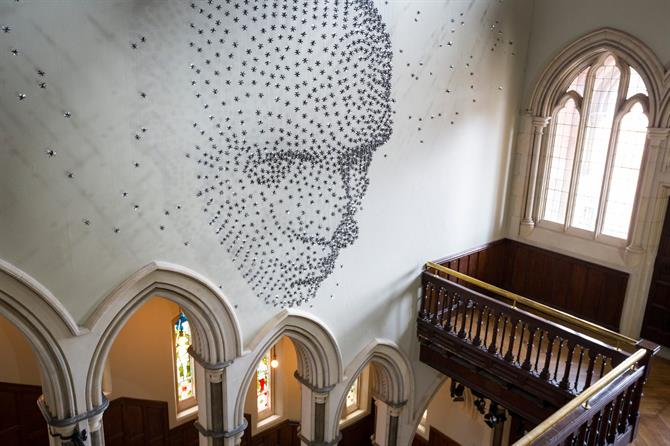Sculpture of a face made out of 2000 stainless steel stars