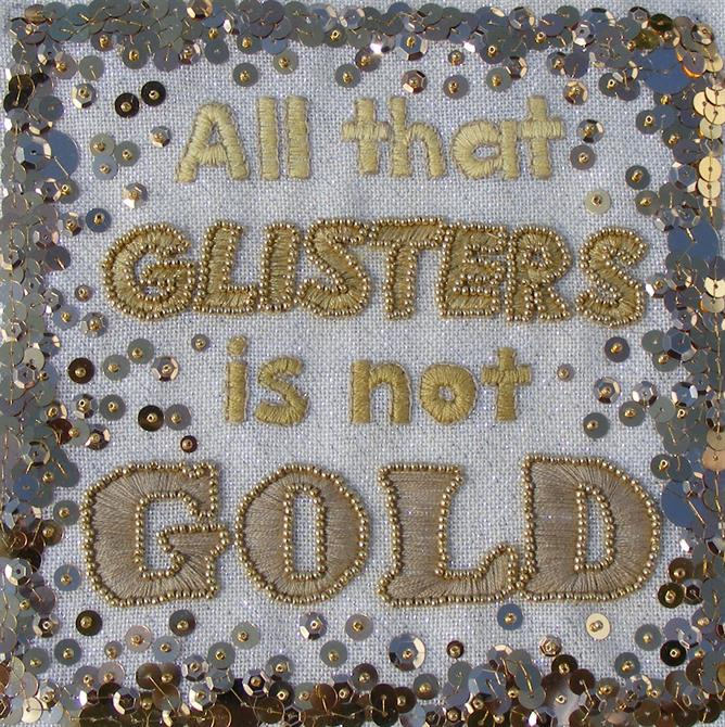 Embroidery in gold with sequins featuring the quote 'All that glisters is not gold'.