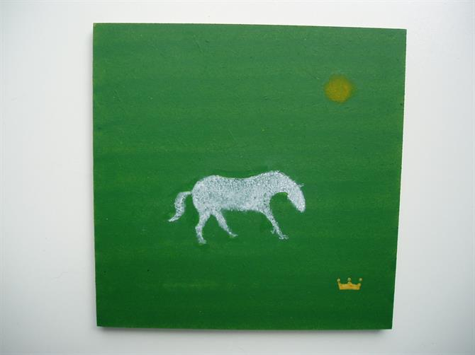 Green backdrop featuring stencils of a white horse, yellow sun and crown.