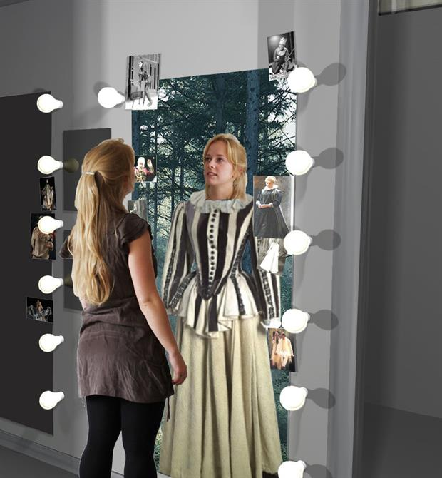 A woman in casual clothes stands in front of a mirror - the image reflected back shows her in Jacobean costume