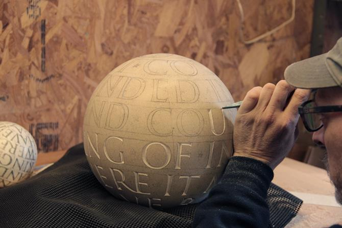 Gary Breeze chiselling the stone sphere