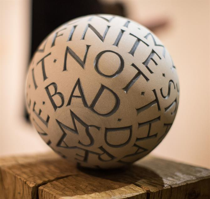stone carved sphere with quote from Hamlet