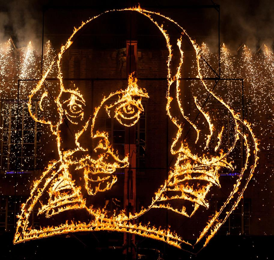 Shakespeare's face in fire on the front of the Royal Shakespeare Theatre