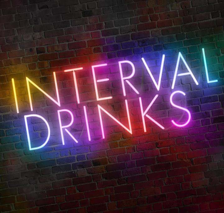 Interval Drinks written in neon on a brick background
