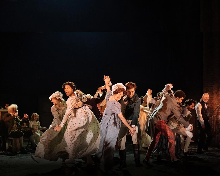 A group of men and women dancing merrily.