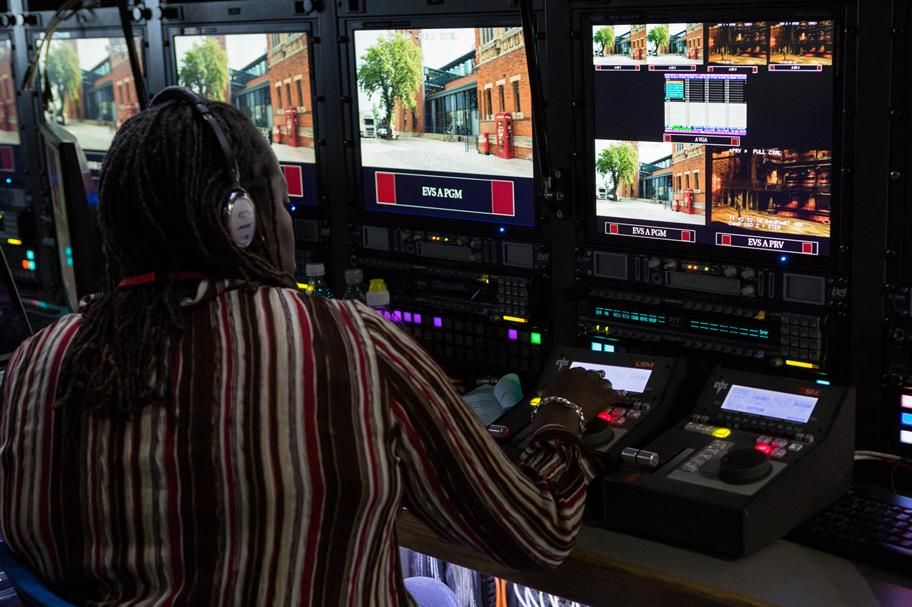 A technician in front of several screens managing a Live From Stratford broadcast