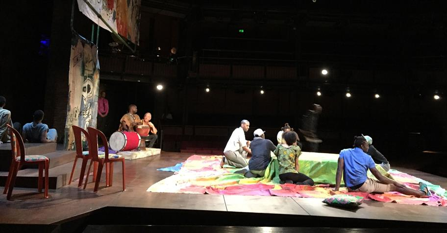 Cast of Hamlet on stage with colourful drapes