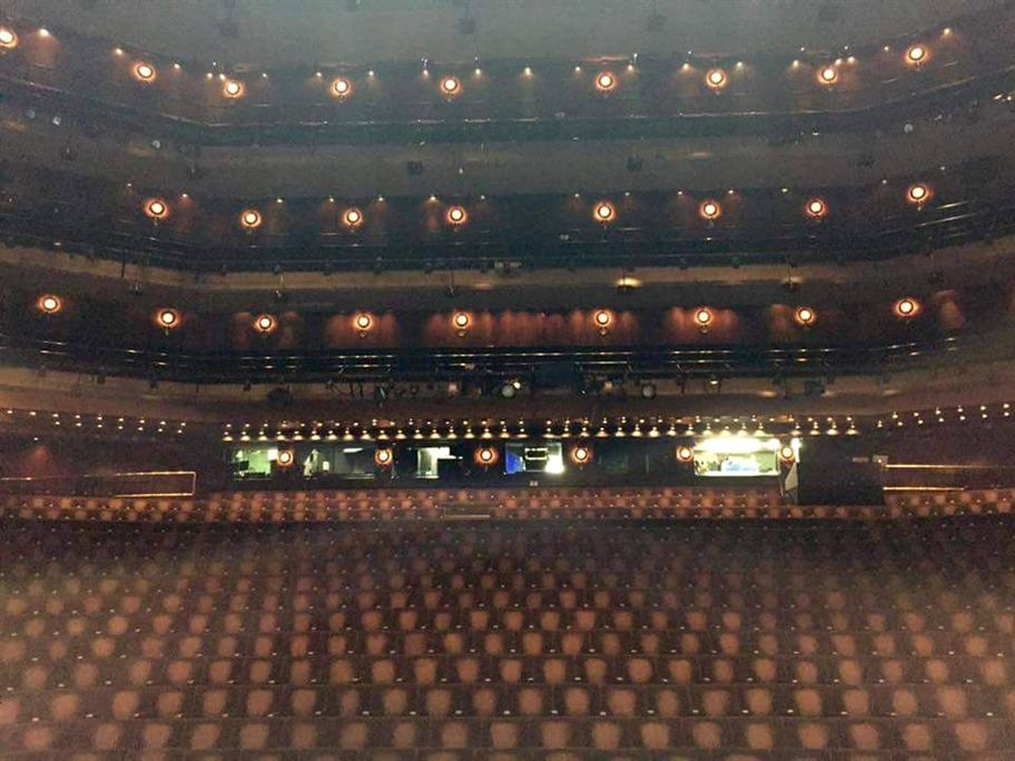 The auditorium of the Barbican Theatre, overlooking the stall with many rows of seats