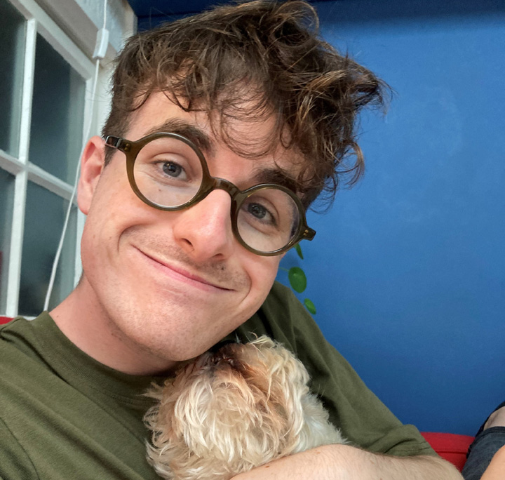 Joe Kerry smiling with his dog