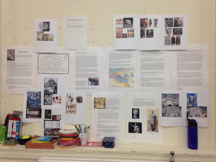 A noticeboard with research about Rome pinned all over it