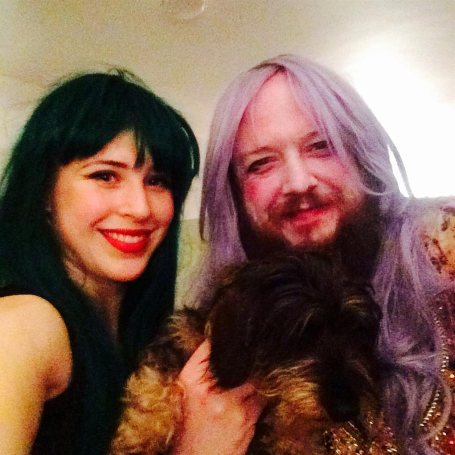 Eleanor Wyld, John Cummins (in wigs) and puppy Zeus at the party