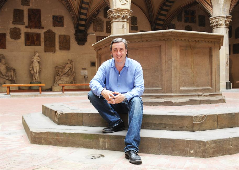 Andrew Graham-Dixon seated on a monument