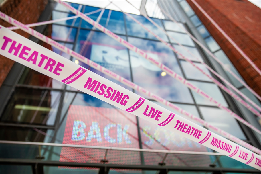 Royal Shakespeare Theatre exterior wrapped in pink hazard tape reading 'missing live theatre'