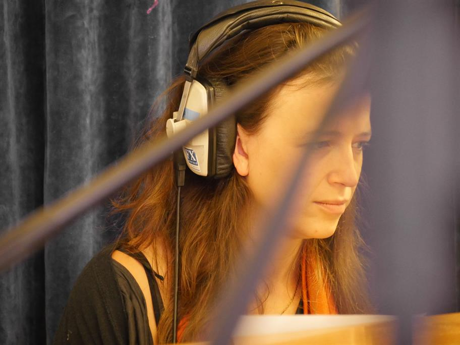 Sarah Llewellyn wearing headphones