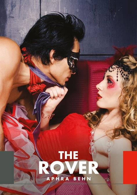 The Rover marketing image showing a couple in brightly coloured clothing and decorations, the woman pulling the man to her by his tie
