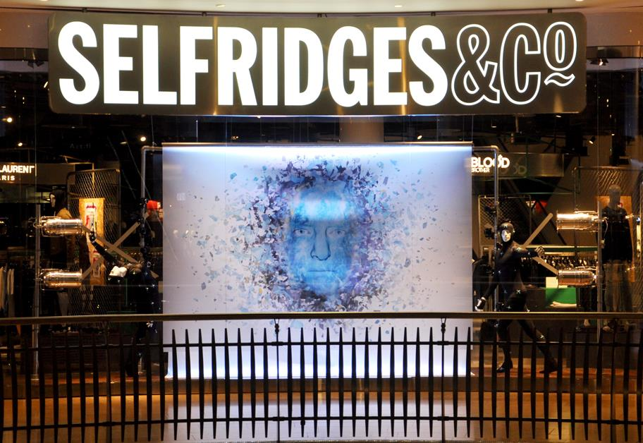 Blue Prospero face at the centre of the Selfridges window