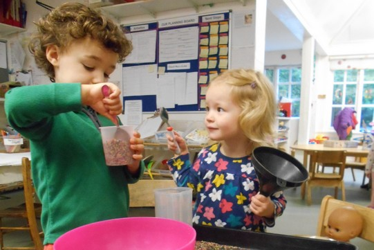 Two children cooking