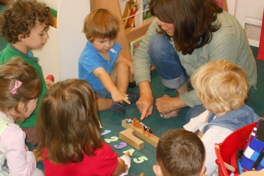 a group of children playing a numbers game