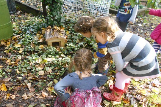 children in the garden with the fallen leaves
