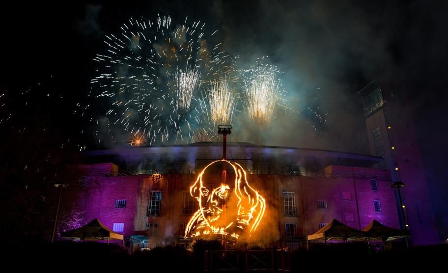 Shakespeare's face depicted in fireworks in front of the Royal Shakespeare Theatre