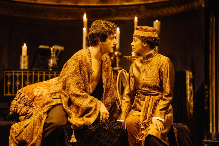 Orsino and Viola look into each other's eyes.