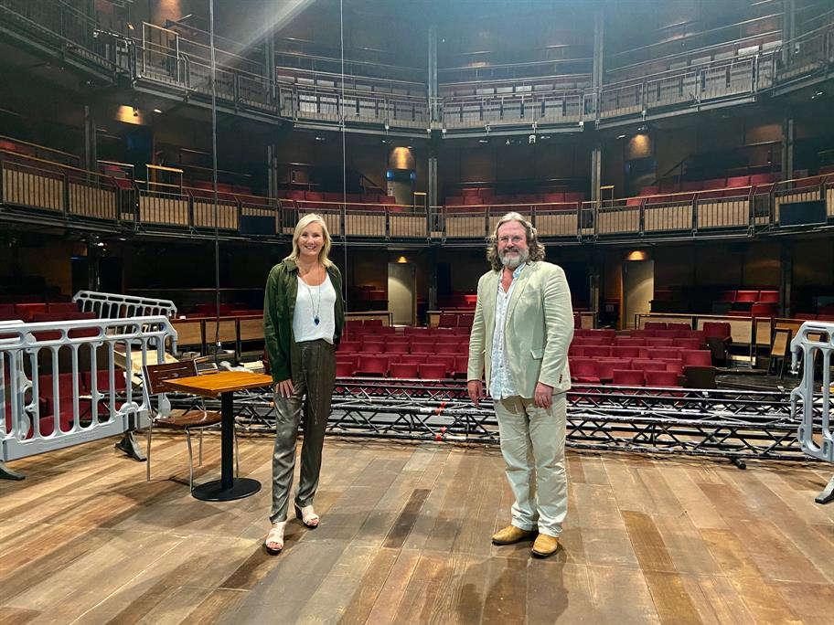 Caroline Dinenage standing on the stage with Gregory Doran