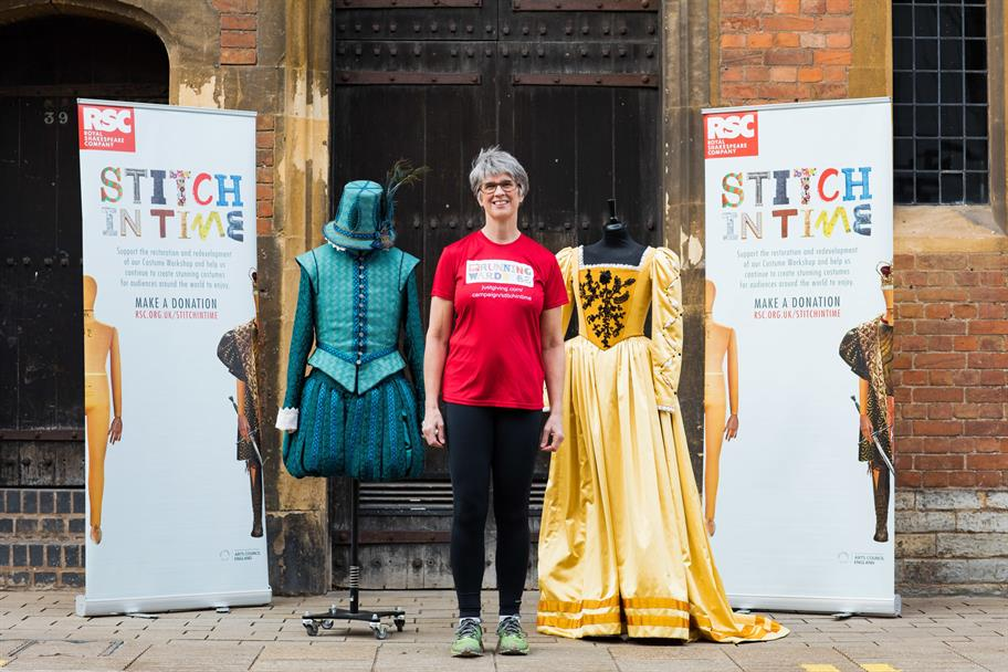 A woman in running gear poses by two costumed mannequins and Stitch In Time banners.