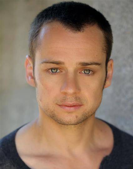 headshot of Alex Waldmann looking directly at camera