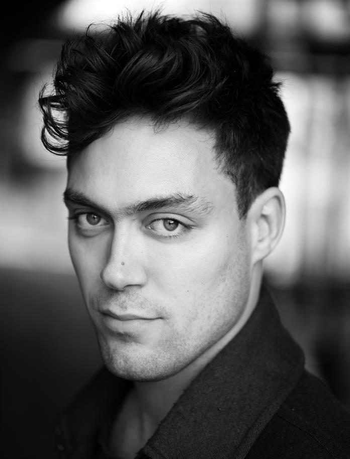 Headshot of Alex Hassell