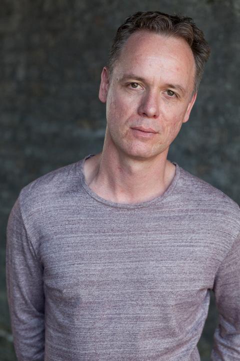Jamie Ballard wearing a grey jumper